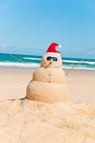 snowman sunbathing on the beach